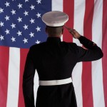 Man in U.s. Marine Corps Uniform Saluting American Flag
